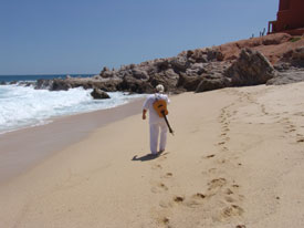 Greg walking on the beach in Cabo